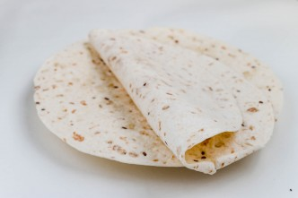 Stack of tortilla wraps and one folded wrap