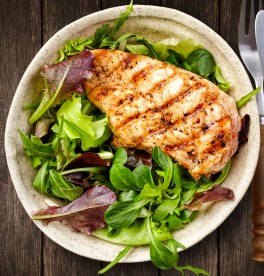 Bowl of green salad and grilled chicken fillet
